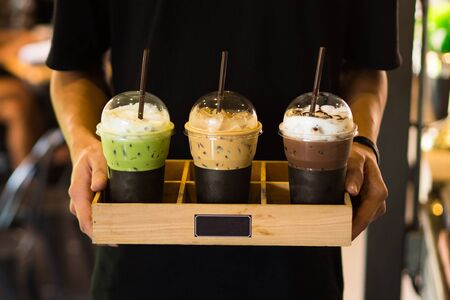 Photo pour Men holding Beverage drinks ready to serve,cafe style,green tea ,coffee,chocolate - image libre de droit