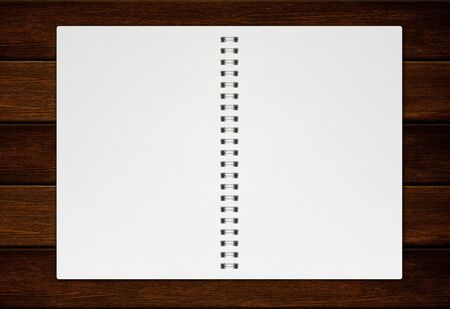 Photo for flat lay of empty notebook mockup isolated on wood table background - Royalty Free Image