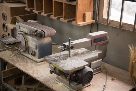 Photo pour Photo of  grinding machine and electric jigsaw machine in a workshop - image libre de droit