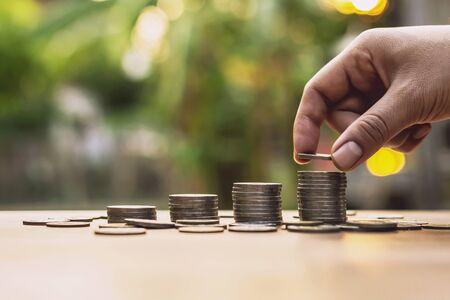 Foto de Placing the coin as a step Investment concepts and saving Growing business - Imagen libre de derechos
