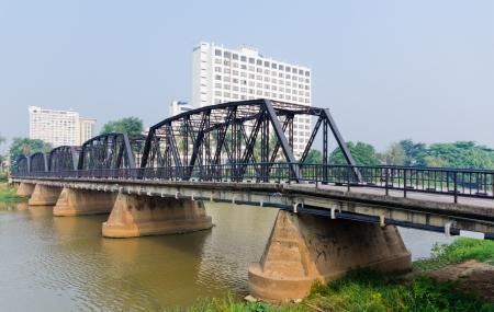 Old Steel Bridge near Nawarat Bridge at Chiangmai, Thailand.