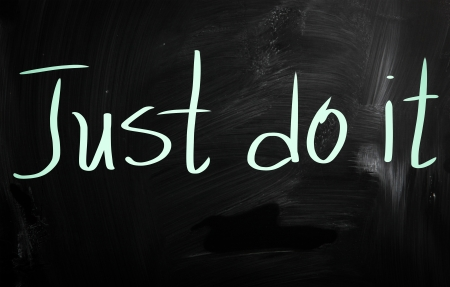 Just Do It handwritten with white chalk on a blackboard