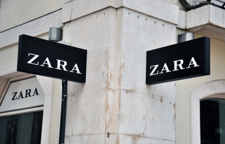 Lisbon, Portugal - December 25, 2013: Zara store sign on the grey building on Agusta street in Baixa district of Lisbon on December 25, 2013. Lisbon is the largest city and capital of Portugal with a population of 547 000 citizens.