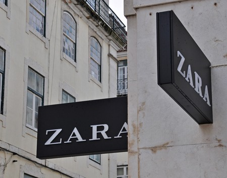 LISBON, PORTUGAL - DECEMBER 25: Zara store sign on the grey building on Agusta street in Baixa district of Lisbon on December 25, 2012. Lisbon is the largest city and capital of Portugal with a population of 547 000 citizens.