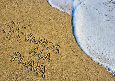 Let's go the beach sign on spanish