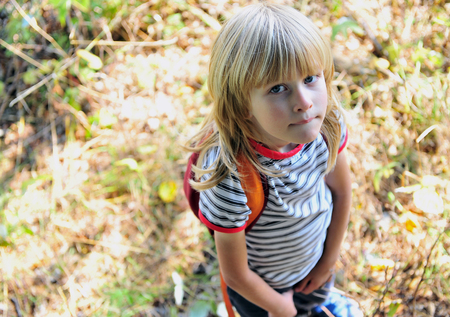 Foto de Top view of little boy with backpack outdoors - Imagen libre de derechos