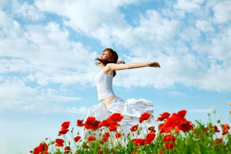 Photo for beauty woman in poppy field in white dress - Royalty Free Image