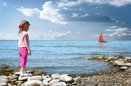 little girl wait boat with scarlet sail