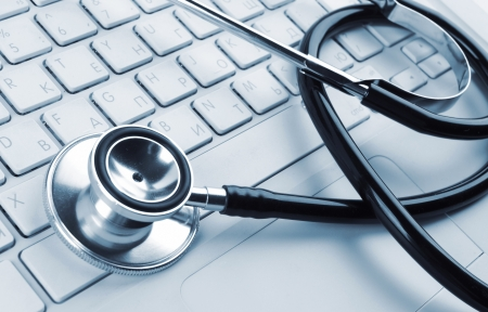 stethoscope on a white laptop computer