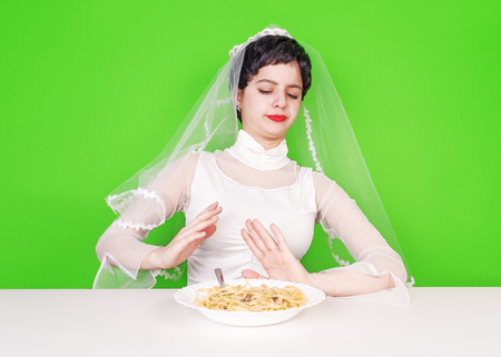 Stop the flour. The bride shows by hands the refusal of high-calorie food for the sake of his beautiful figure