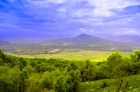Foto de Mountain landscape in Abkhazia in the valley of Auadhara. Panorama with yellow autumn hills and mountains. The photo was taken in the valley of the seven lakes, the Republic of Abkhazia. - Imagen libre de derechos