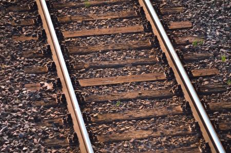 Railway tracks with wood background