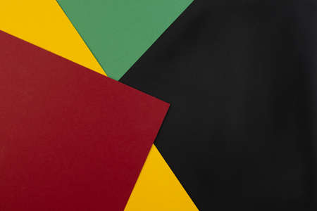 Photo for February Black History Month. Abstract Paper geometric black, red, yellow, green background. Copy space, place for your text. Top view. - Royalty Free Image