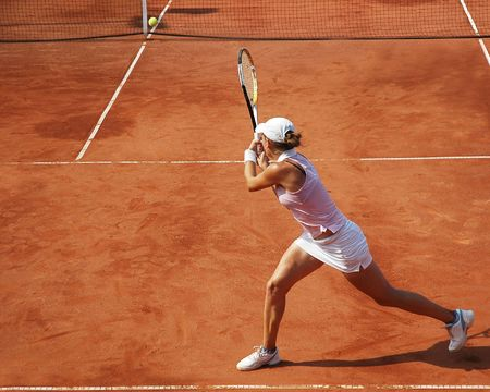 Woman playing tennis at the professional tournament
