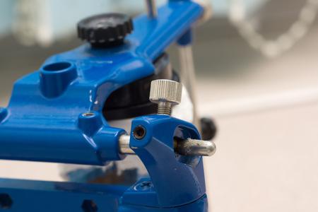 dental articulator with plastered dental bridge models