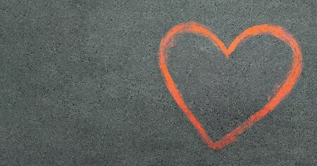 Photo for asphalt texture background. Red heart is a symbol of love drawn on the pavement. chalk drawings on asphalt. copy space - Royalty Free Image