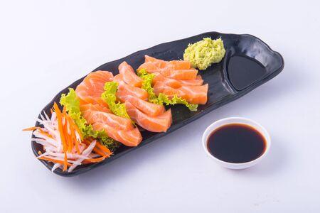 Photo pour Sasimi salmon on white background at restaurant. - image libre de droit