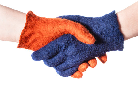 Photo for handshake of two hands in blue and orange gloves isolated on white background - Royalty Free Image