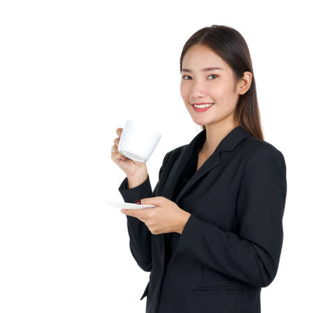 Photo pour Young asian woman in black suit with a smile holding a cup of coffee. Portrait on white background with studio light. Close up - image libre de droit