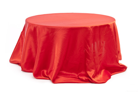 Round table with red cloth  on white background.