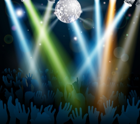 Crowd dancing at a concert or on a disco nightclub dance floor with hands up under a mirror ball with lights