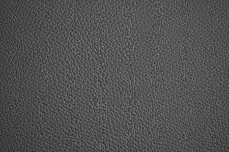 Dark grey leather texture as background