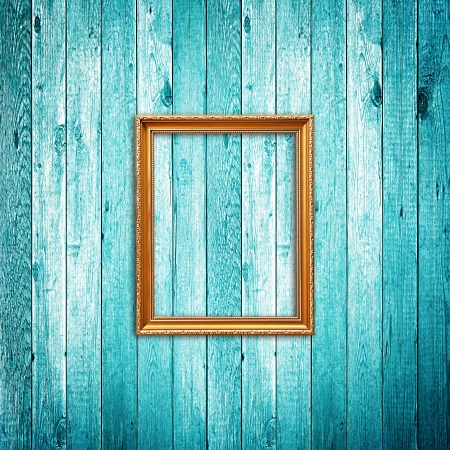 Picture frame on blue wood background