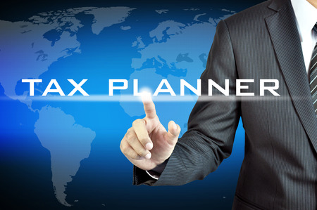 Hand touching TAX PLANNER words on virtual screen - business & financial planning concept