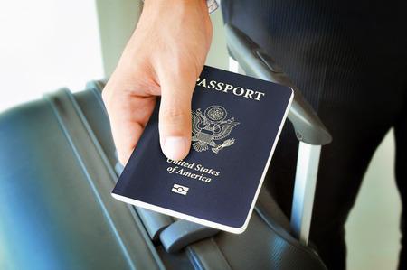 Photo pour Hand holding U.S. passport - image libre de droit