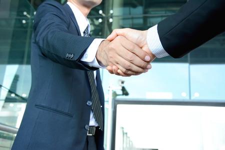Handshake of businessmen - success, dealing, greeting & business partner concepts