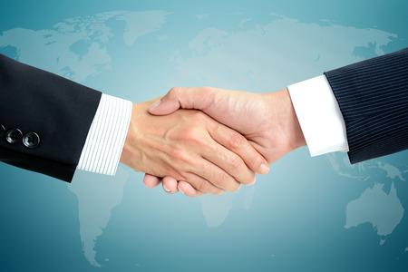 Photo pour Handshake of businessmen - business partner, greeting & dealing concepts - image libre de droit