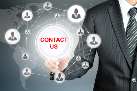 Businessman pointing on CONTACT US sign on virtual screen with people icons linked as network