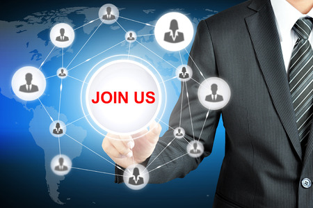 Businessman hand pointing on JOIN US sign on virtual screen with human icons linked as network
