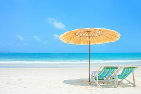Blue sea and white sand beach with beach chairs and parasol at Samed island, Thailand - holiday and vocation concepts