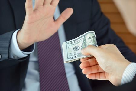 Businessman refusing money, uncorrupted concept - soft focused