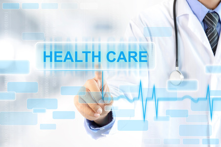 Photo pour Doctor hand touching HEALTH CARE sign on virtual screen - image libre de droit