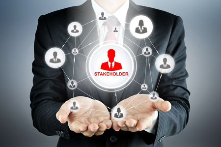 SHAREHOLDER sign connected with businesspeople icon network on businessman hands