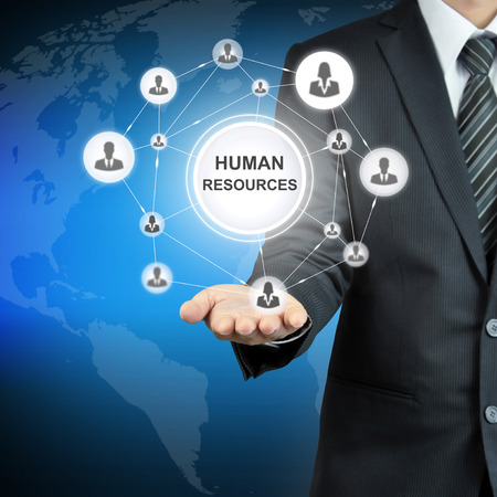 HUMAN RESOURCES sign with people icon network on businessman hand