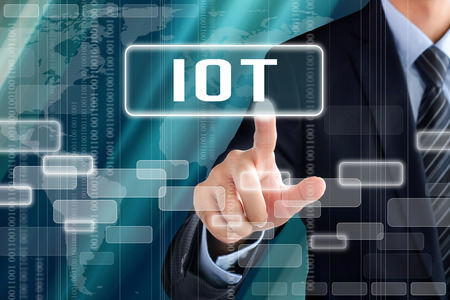 Businessman hand touching IOT (Internet of Things) sign on virtual screen