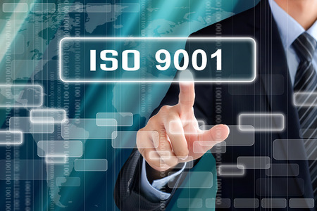 Businessman hand touching ISO9001 sign on virtual screen