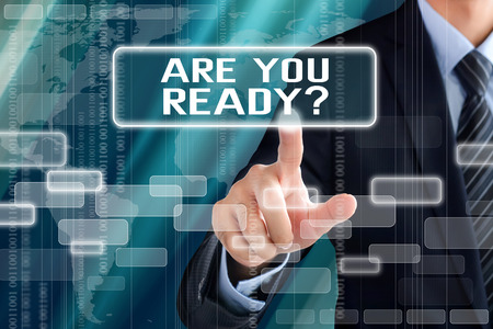 Businessman hand touching ARE YOU READY text on virtual screen