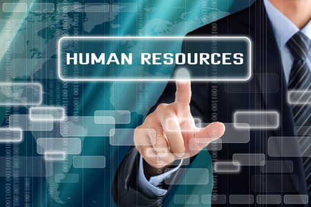 Businessman hand touching HUMAN RESOURCES sign on virtual screen