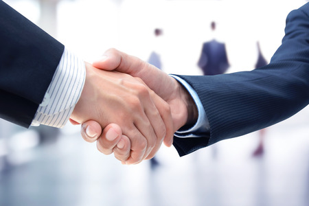 Foto de Handshake of businessmen on blur businesspeople background - greeting, dealing,  merger and a acquisition concepts - Imagen libre de derechos