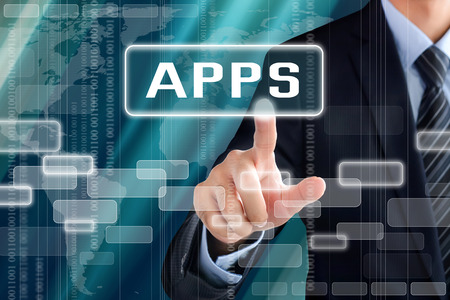 Businessman hand touching APPS tab on virtual screen