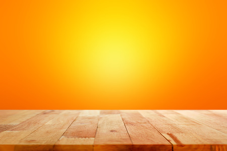 Photo pour Wood table top on gradient orange background - can be used for display or montage your products - image libre de droit