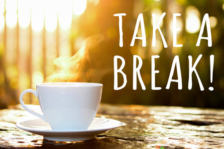 TAKE A BREAK text with coffee cup in blur bokeh of morning sunlight background - coffee break poster