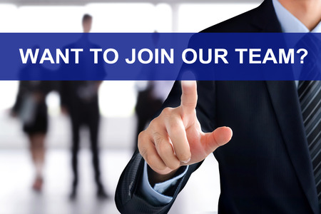 Businessman hand touching WANT TO JOIN OUR TEAM? message on virtual screen