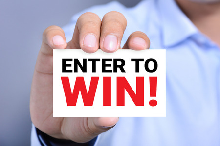 ENTER TO WIN !, message on the card held by a man hand