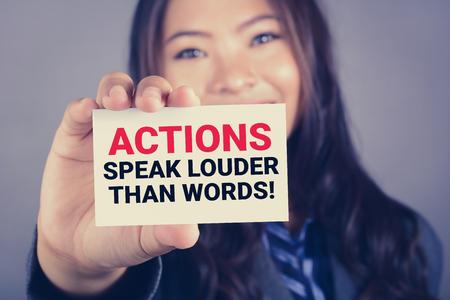 Photo pour ACTIONS SPEAK LOUDER THAN WORDS, message on the card shown by a woman - image libre de droit