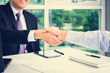 Photo pour Handshake of businessmen in the office - making agreement and dealing concepts - image libre de droit